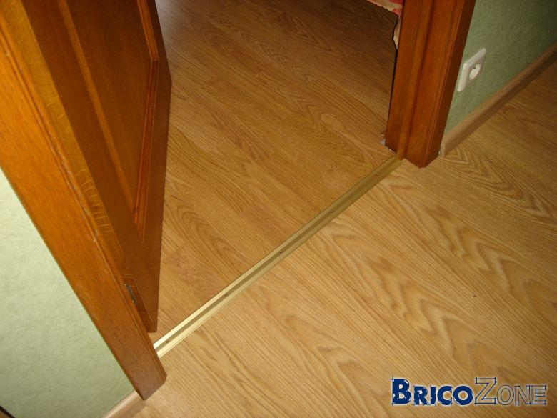 Pose quickstep a l 39 envers for Passage de porte parquet