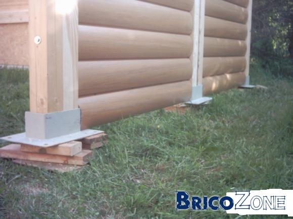 Abris à bois : dalle de béton ou plots béton ?