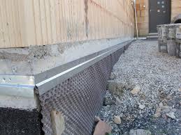 Barri re d 39 tanch it au niveau du sol for Protection mur exterieur enterre