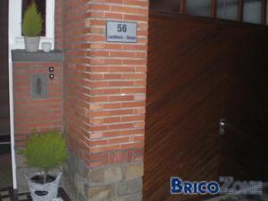 Forage dans façade pour plaque numéro